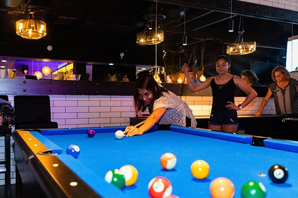 Black and Blue - Customers playing Billiards