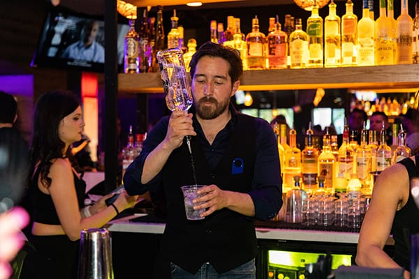 Black and Blue - Bartender preparing a drink